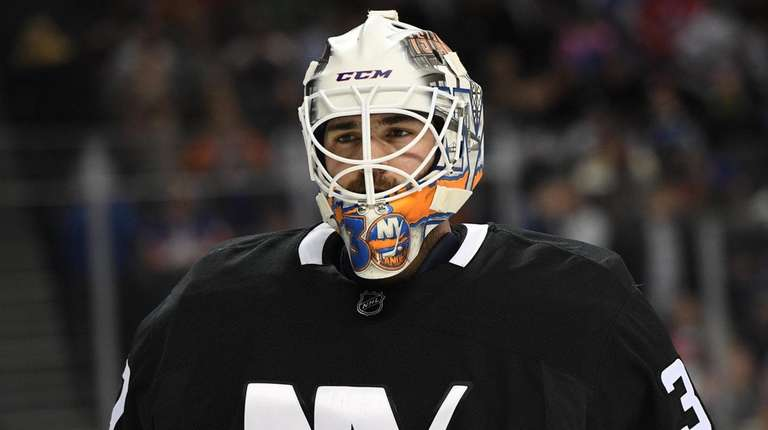 New York Islanders goalie Jean-Francois Berube looks on