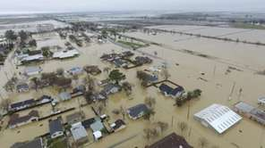 Major flooding in Maxwell, Calif., is seen Saturday,