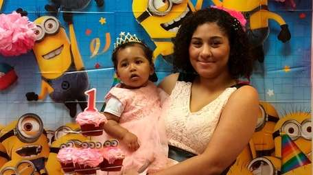 Kimberly Alcequiez and her daughter, Kaitlyn, at her