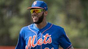 New York Mets shortstop Amed Rosario looks on during