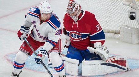 New York Rangers' Chris Kreider moves against Montreal