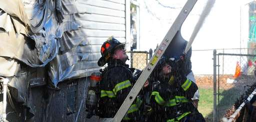Firefighters from three Nassau County departments battled a