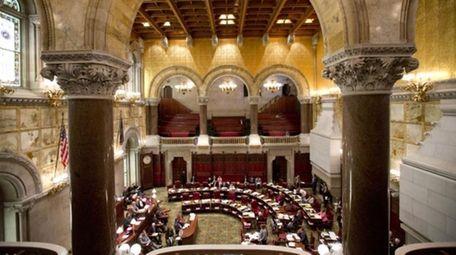 Senators work in the Senate Chamber at the