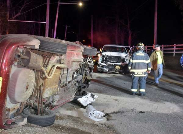 Firefighters respond to a crash at Mill and