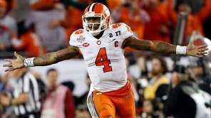 Clemson's Deshaun Watson celebrates a last-second touchdown pass