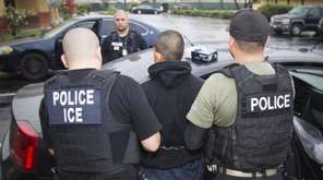 U.S. Immigration and Customs Enforcement officers detain a