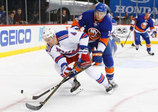 Adam Clendeningof the New York Rangers tries to