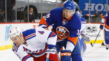 Adam Clendening of the New York Rangers tries to