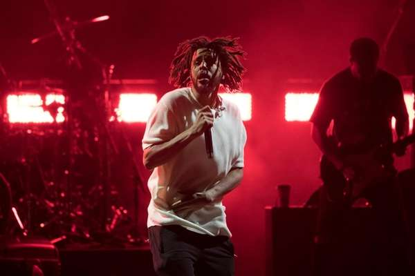 J. Cole performs during a campaign rally for