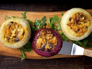Onions stuffed with herbs and cheese.