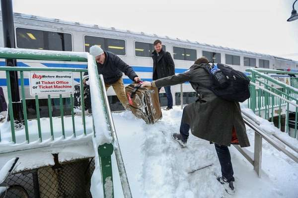 A Long Island Rail Road rider is helped