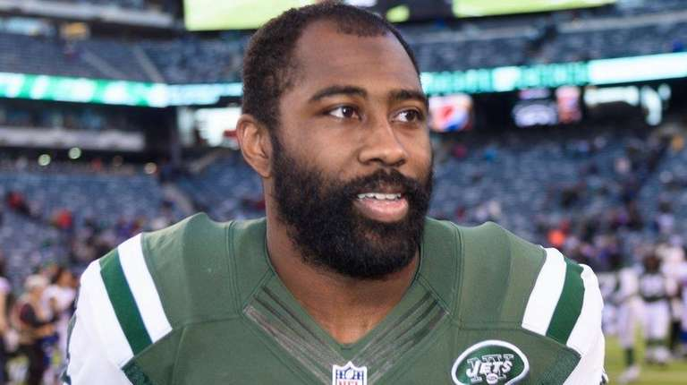 New York Jets cornerback Darrelle Revis leaves the