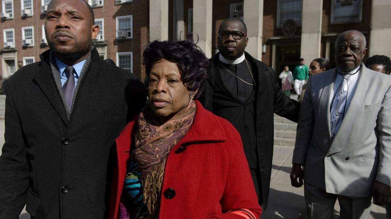 Activist Floyd Jarvis, left, outside a Queens courthouse