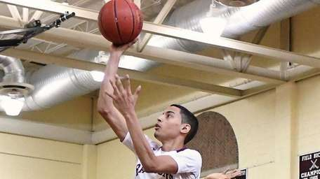 Angel Rivera scores two of his 22 points