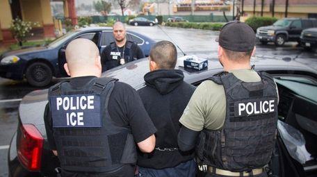U.S. Immigration and Customs Enforcement officers arrest a