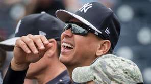 Former New York Yankees third baseman Alex Rodriguez talks with