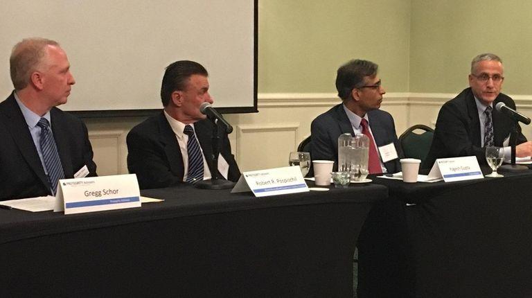 From left, Gregg Schor, of Protegrity Advisors, Robert