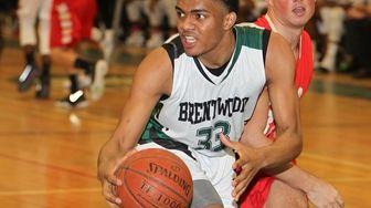 Brentwood's Jason Feliz (33) grabs a rebound while