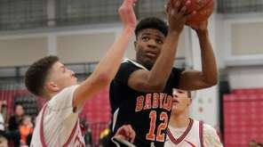 Babylon's Gejuan Booker (12) drives against Center Moriches'