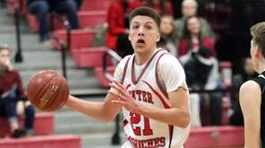 Center Moriches' Sean Braithwaite (21) drives against Babylon's