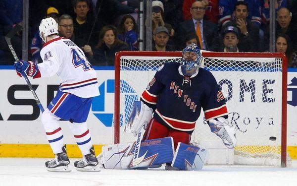 Rangers goaltender Henrik Lundqvist reacts after surrendering the