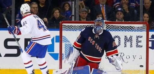 Rangers goaltender Henrik Lundqvist reacts after surrendering the