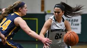 Christiana de Borja #21 of Harborfields, right, gets