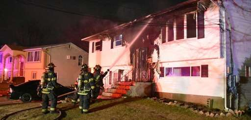 Firefighters respond to a house fire on Peterson