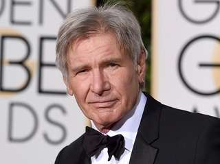 Harrison Ford arrives at the 73rd annual Golden