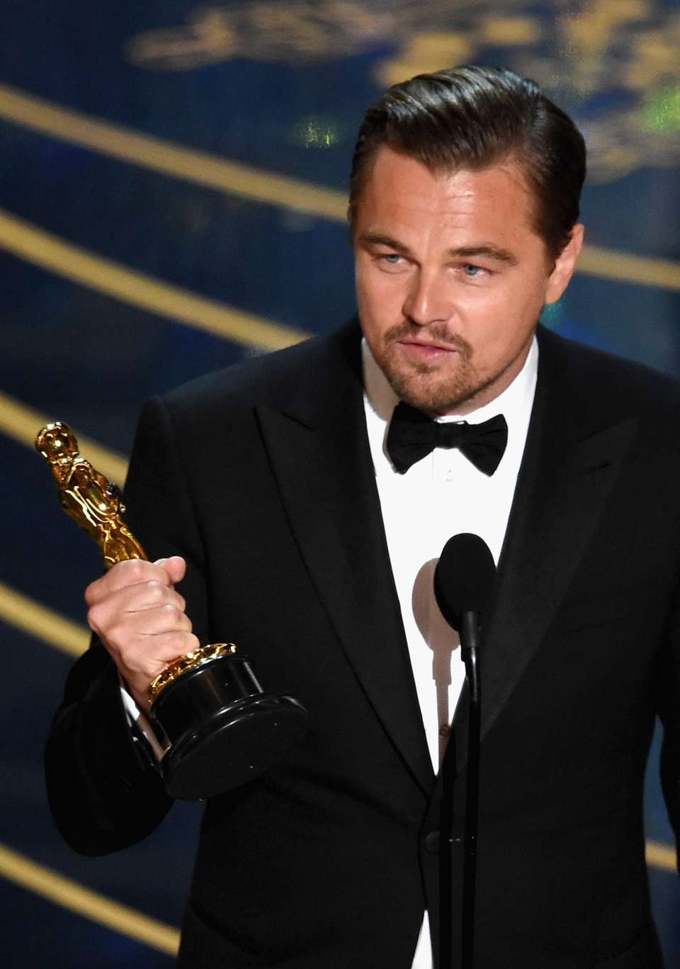 Actor Leonardo DiCaprio accepts the Oscar statuette for