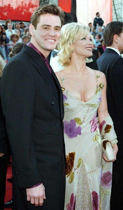 Jim Carrey and his then wife Lauren Holly