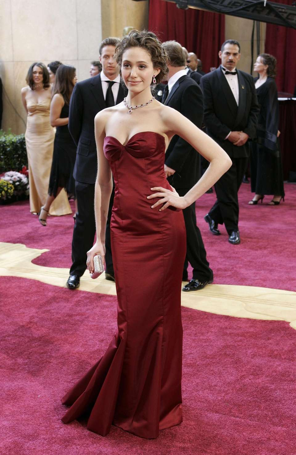 Emmy Rossum arrives at the 77th Academy Awards