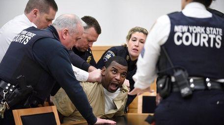 Kwauhuru Govan is restrained in Brooklyn Superior Court
