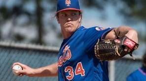 NY Mets pitcher Noah Syndergaard throws a bullpen
