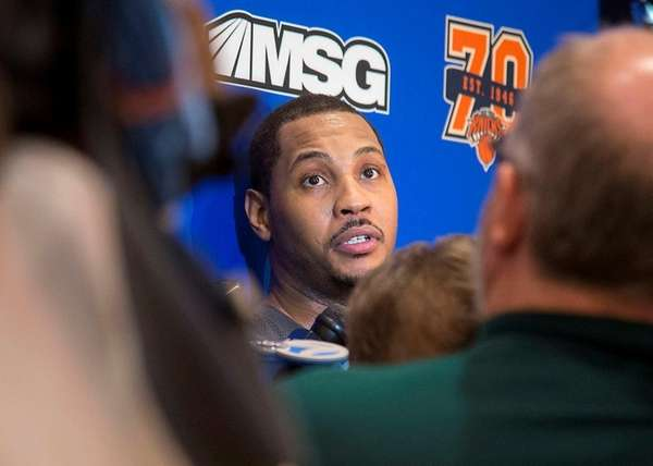 Carmelo Anthony talks with the media after Knicks