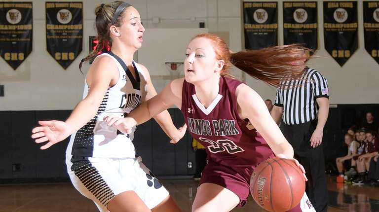 Kings Park's Tiffany Slicklein (32) drives to the