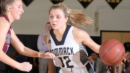Commack's Jillian Spagnuola (12) drive to the basket