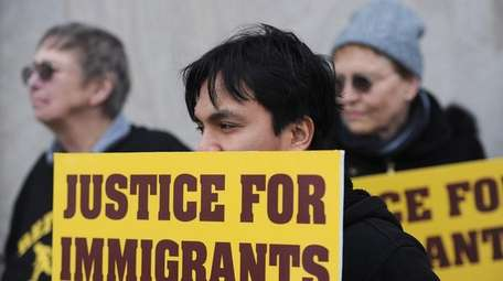 Chris Magno, of Erie, Pa., holds a pro-immigration