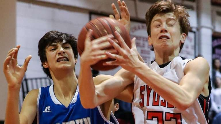 Syosset's Robert Kula goes for the rebound with