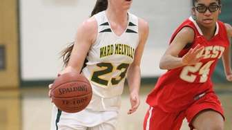 Ward Melville's Taylor Tripptree (23) brings the ball