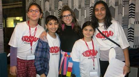 Madisyn Shipman, center, with Kidsday reporters from left,