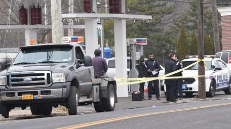 Suffolk County police investigate on Thursday, Feb. 23,