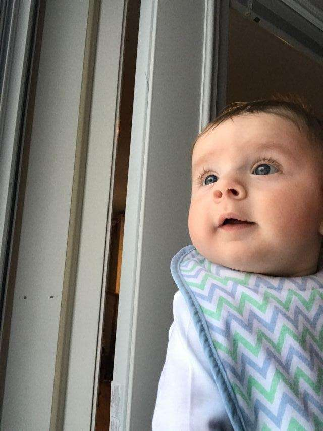 Baby Nicholas looking at his first snow storm