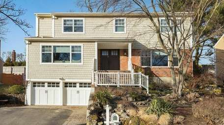 This Syosset Colonial, listed for $999,000 in February