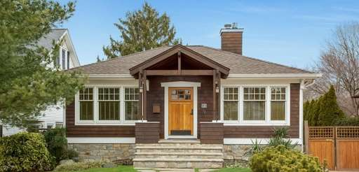 This custom Craftsman home in Huntington is on