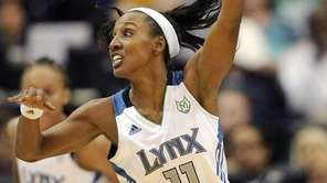 Candice Wiggins of the Minnesota Lynx guards against Tamika