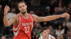 Houston Rockets guard K.J. McDaniels reacts after making