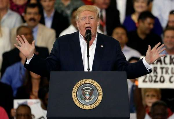 President Donald Trump gestures during his