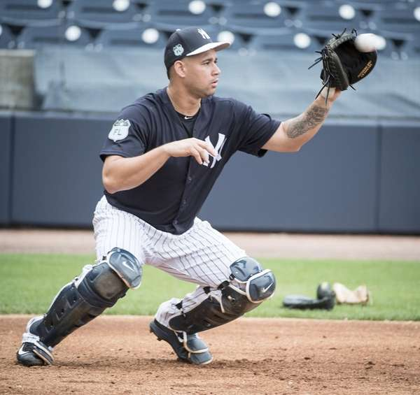 Yankees catcher Gary Sanchez does exercising drills from