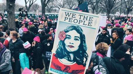 Demonstrators gather last month at the Women's March